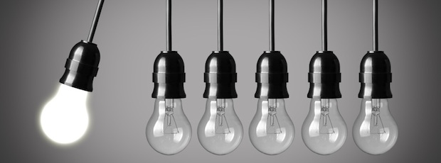 Perpetual motion with light bulbs. Idea concept on gray background
